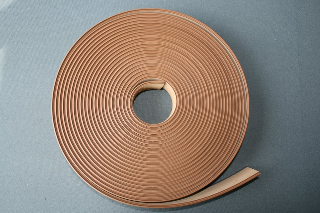Coiled flexible plastic decking product