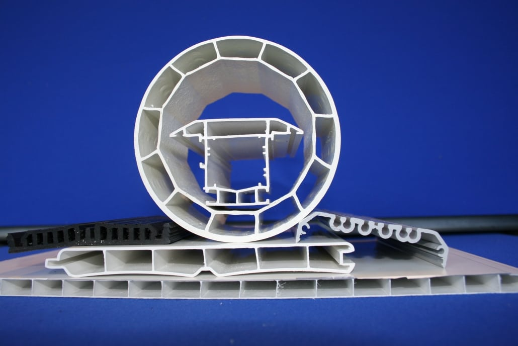 a selection of white plastic extrusions for building and construction
