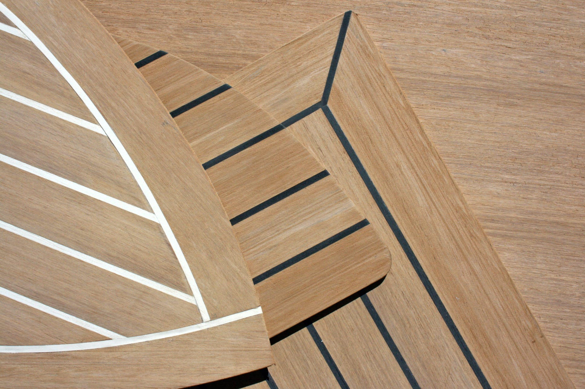 Rigid synthetic marine decking co-extruded to look and feel like real teak