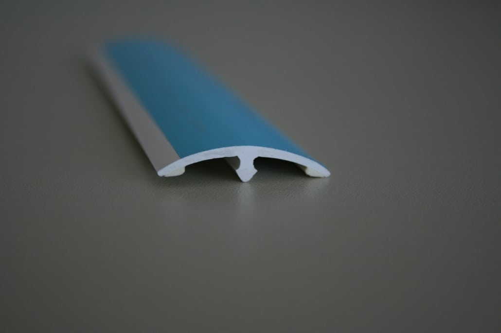 top part of a co-extruded division bar in blue