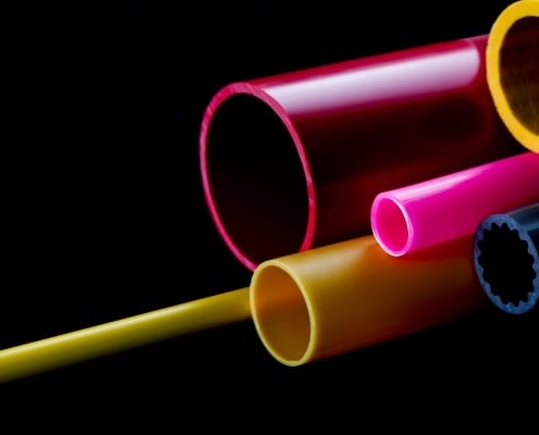 pink and yellow coloured rigid plastic tubes