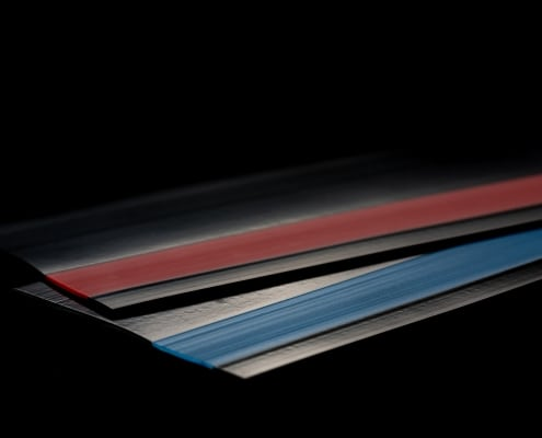 flexible co extrusions in red and blue