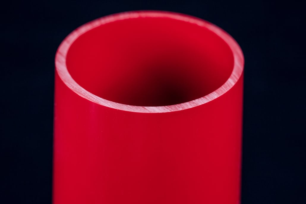Red rigid tube extrusion